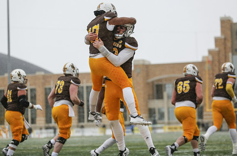 Wyoming wide receiver Raghib Ismail Jr. (17) celebrates his touchdown with quarterback Tyler Vander Waal (18) during an NCAA college football game against Air Force at War Memorial Stadium Saturday, Nov. 17, 2018, in Laramie, Wyo. (Josh Galemore/The Casper Star-Tribune via AP)