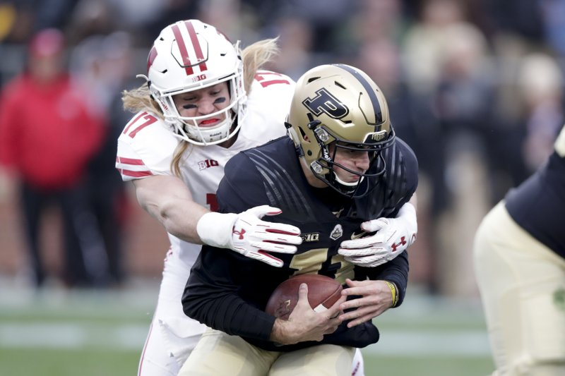 Wisconsin linebacker Andrew Van Ginkel (17) sacks Purdue quarterback David Blough (11) during the first half of an NCAA college football game in West Lafayette, Ind., Saturday, Nov. 17, 2018. (AP Photo/Michael Conroy)