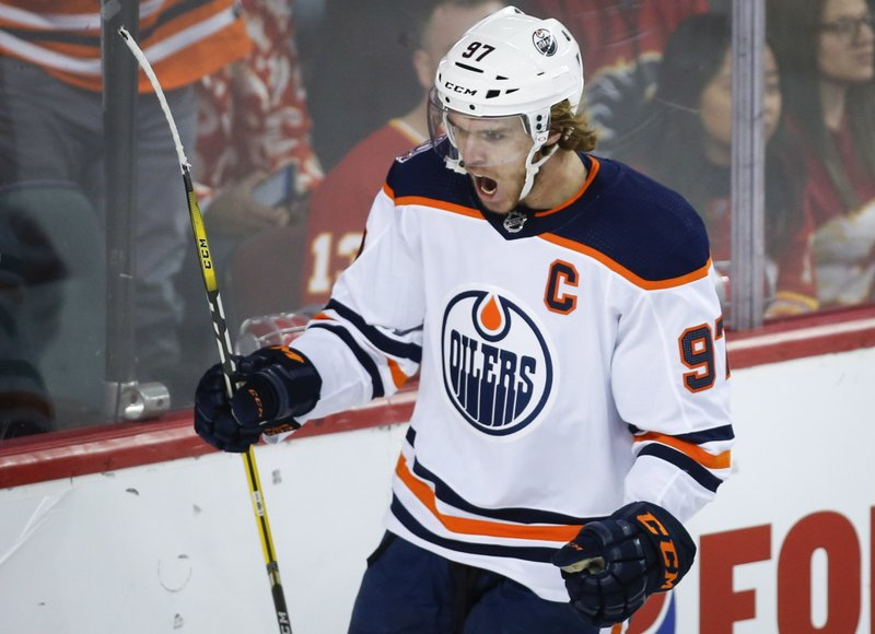 Edmonton Oilers' Connor McDavid celebrates his goal against the Calgary Flames during the second period of an NHL hockey game Saturday, Nov. 17, 2018, in Calgary, Alberta. (Jeff Macintosh/The Canadian Press via AP)