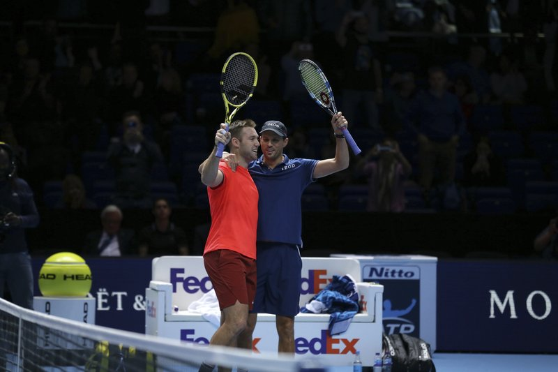 Mike Bryan, right, and Jack Sock of the United States celebrate after defeating Pierre-Hugues Herbert and Nicolas Mahut of France during their ATP World Tour Finals doubles final tennis match at the O2 Arena in London, Sunday Nov. 18, 2018. (AP Photo/Tim Ireland)