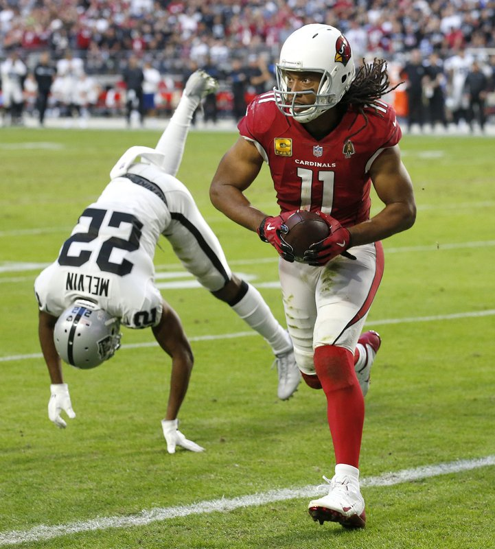Arizona Cardinals wide receiver Larry Fitzgerald (11) scores a touchdown as Oakland Raiders cornerback Rashaan Melvin (22) defends during the second half of an NFL football game, Sunday, Nov. 18, 2018, in Glendale, Ariz. (AP Photo/Ross D. Franklin)