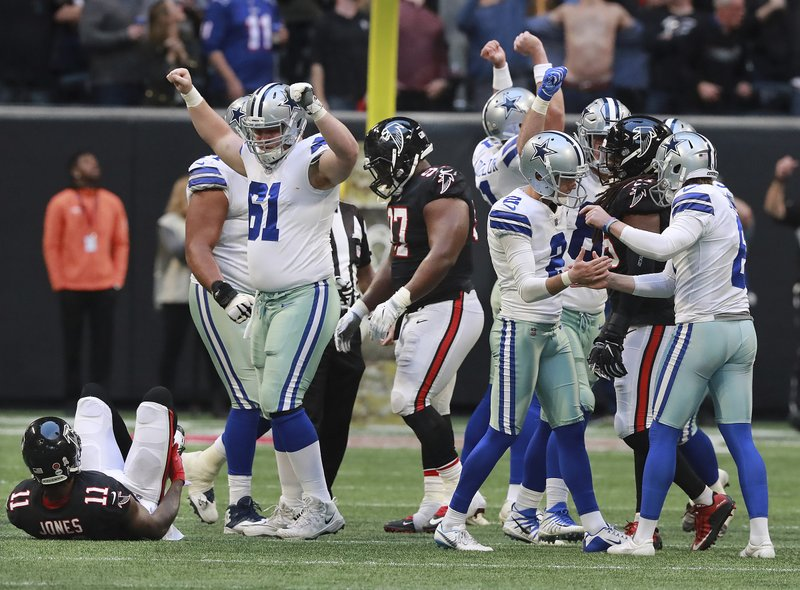 Dallas Cowboys kicker Brett Maher and teammates celebrate his field goal for a 22-19 victory over the Atlanta Falcons as time expired in an NFL football game Sunday, Nov. 18, 2018, in Atlanta. Falcons' Julio Jones lies on the ground after trying to block the attempt. (Curtis Compton/Atlanta Journal-Constitution via AP)
