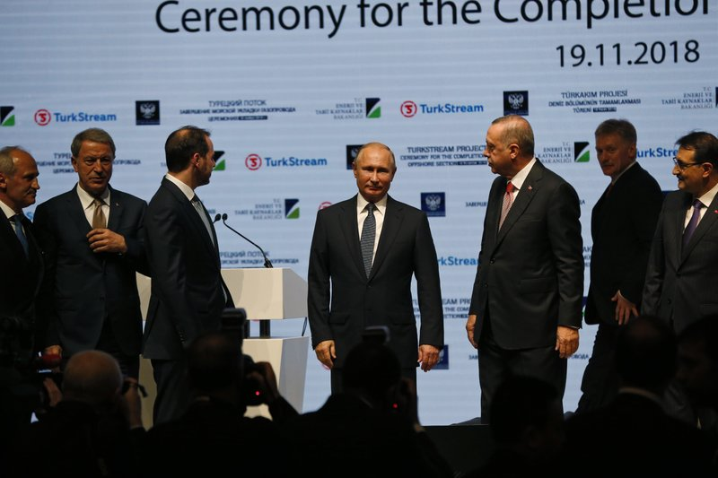 Turkey's President Recep Tayyip Erdogan, 3rd right, looks at Russian President Vladimir Putin, centre, following an event marking the completion of one of the phases of the Turkish Stream natural gas pipeline, in Istanbul, Monday, Nov. 19, 2018. (AP Photo/Lefteris Pitarakis)