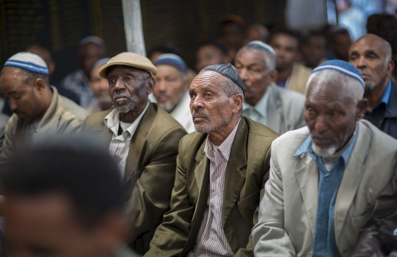 Members of Ethiopia's Jewish community gather to protest the Israeli government's decision not to allow all of them to emigrate to Israel, leaving their families divided between the two countries, at the synagogue in Addis Ababa, Ethiopia, Monday, Nov. 19, 2018. Representatives of the 8,000 Jews in Ethiopia urged the Ethiopian Jews living in Israel to think carefully before voting for Israel's ruling party, the Likud, over the delays in repatriation to Israel. (AP Photo/Mulugeta Ayene)