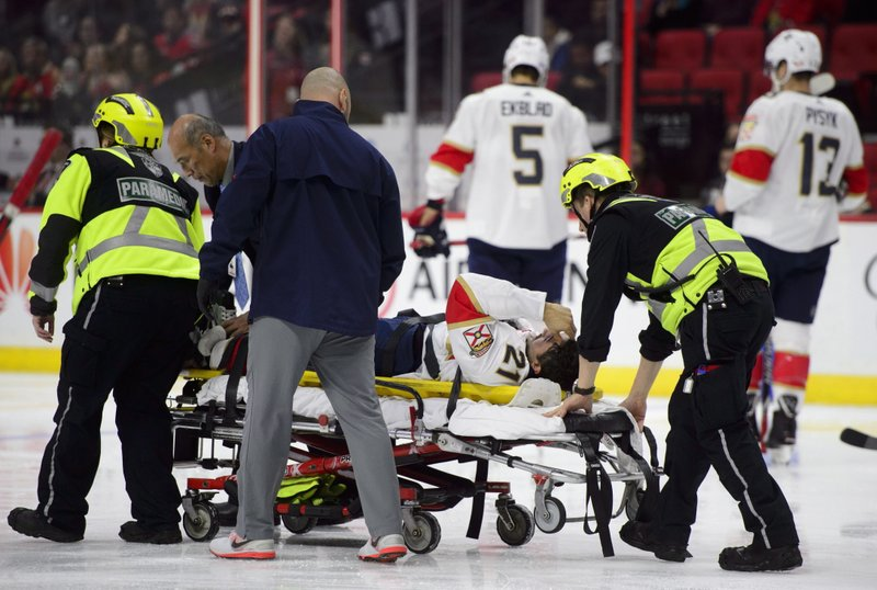 Florida Panthers centre Vincent Trocheck (21) is taken off the ice on a stretcher while taking on the Ottawa Senators during first period NHL hockey action in Ottawa on Monday, Nov. 19, 2018. (Sean Kilpatrick/The Canadian Press via AP)