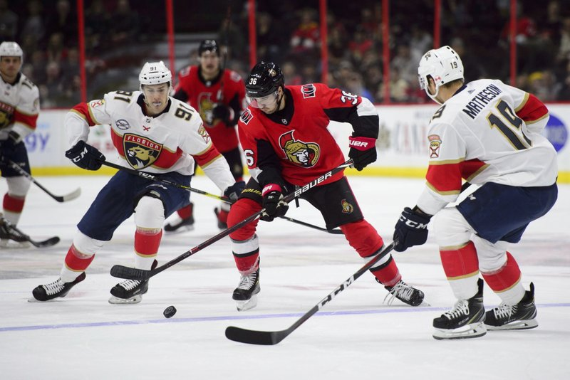 Ottawa Senators centre Colin White (36) skates with the puck between Florida Panthers right wing Juho Lammikko (91), and defenseman Mike Matheson (19) during second period NHL hockey action in Ottawa on Monday, Nov. 19, 2018. (Sean Kilpatrick/The Canadian Press via AP)