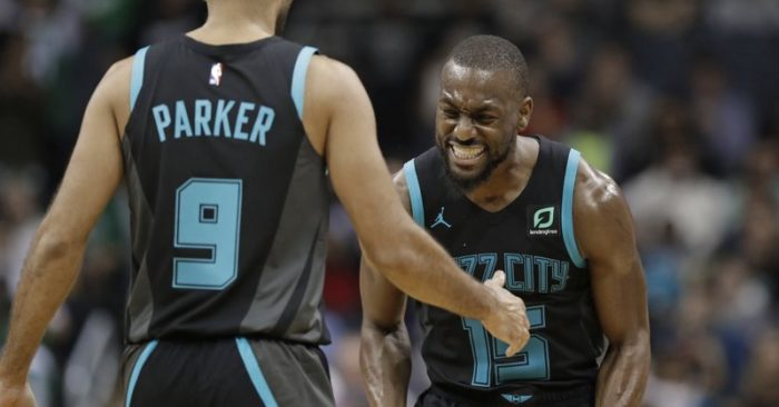 823b0e8bdb71 Charlotte Hornets  Kemba Walker (15) celebrates with Tony Parker (9) after  Parker s basket against the Boston Celtics late in the second half of an  NBA ...