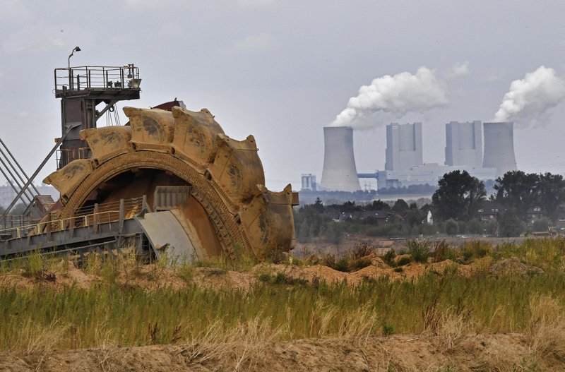 FILE - In this Aug. 27, 2018 file photo a bucket wheel digs for coal near the Hambach Forest near Dueren, Germany. Environmental groups say 10 utility companies are responsible for the majority of premature deaths caused by emissions from coal-fired power plants in Europe. In a report published Tuesday, Nov. 20, 2018 five campaign groups, including Greenpeace, blame the companies for 7,600 premature deaths and millions of work days lost across Europe in 2016.  (AP Photo/Martin Meissner, file)