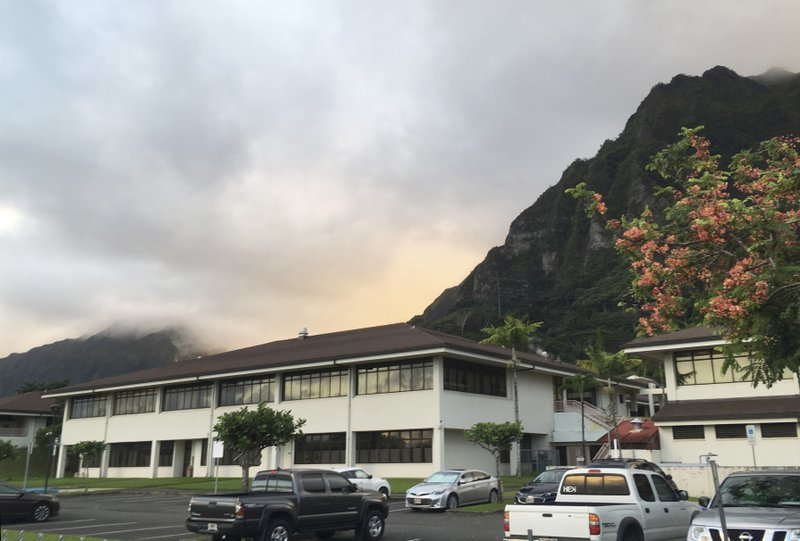 FILE- In this Tuesday, Nov. 14, 2017, file photo, the Hawaii State Hospital is shown in Kaneohe, Hawaii. The Hawaii attorney general's office is wrapping up an investigation into the escape of man committed to a psychiatric hospital after being found not guilty by reason of insanity of a woman's 1979 killing. The attorney general's office says conclusions from an administrative investigation will be released in about two weeks. Saito was captured in Stockton, California, days after walking out of Hawaii State Hospital last year. A court hearing is scheduled Wednesday, Nov. 21, 2018, for escape and identity theft charges against Saito. (AP Photo/Caleb Jones, File)