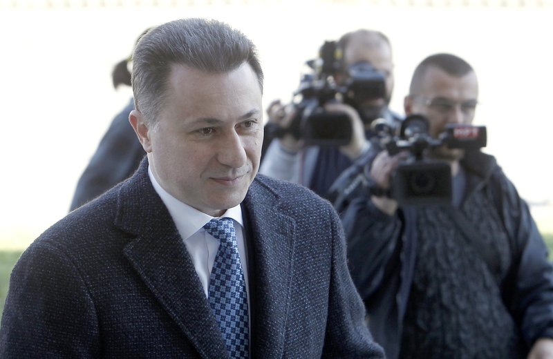 In this picture taken April 2, 2018, former Macedonian Prime Minister Nikola Gruevski, left, arrives at the criminal court in Skopje, Macedonia. Macedonia's fugitive former prime minister Gruevski said Tuesday, Nov. 20, 2018 he has been granted political asylum in Hungary, a week after he fled his country to avoid serving a two-year jail sentence for a corruption conviction. (AP Photo/Boris Grdanoski)