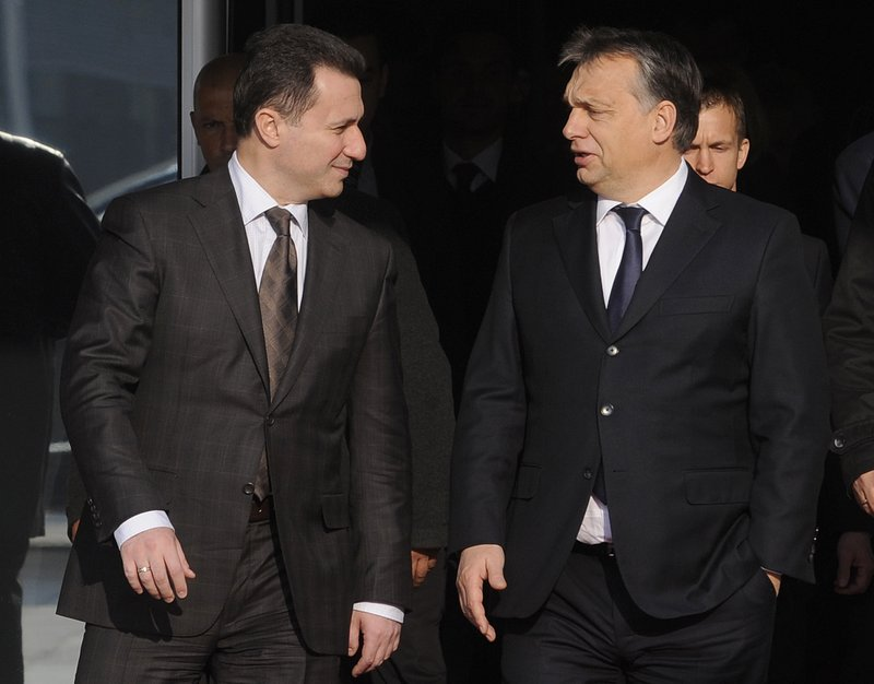 In this picture taken Dec 5, 2013, Macedonian Prime Minister Nikola Gruevski, left, talks to Hungarian Prime Minister Viktor Orban, right, during their meeting in Skopje, Macedonia. Macedonia's fugitive former prime minister Gruevski said Tuesday, Nov. 20, 2018 he has been granted political asylum in Hungary, a week after he fled his country to avoid serving a two-year jail sentence for a corruption conviction. (AP Photo/Boris Grdanoski)