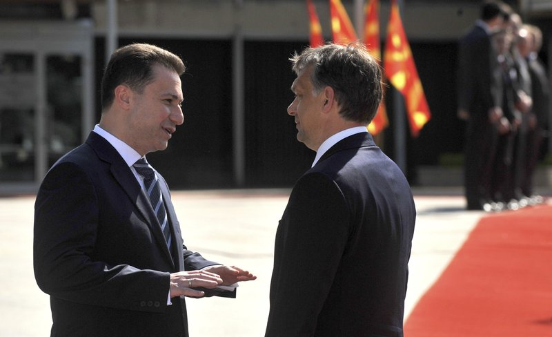 In this picture taken May 12, 2011, Macedonian Prime Minister Nikola Gruevski, left, talks to Hungarian Prime Minister Viktor Orban, right, during a welcome ceremony in Skopje, Macedonia. Macedonia's fugitive former prime minister Gruevski said Tuesday, Nov. 20, 2018 he has been granted political asylum in Hungary, a week after he fled his country to avoid serving a two-year jail sentence for a corruption conviction. (AP Photo/Boris Grdanoski)