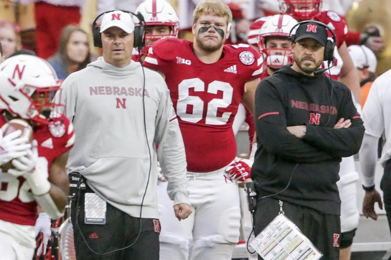 In this Sept. 29, 2018, photo, Nebraska defensive coordinator Erik Chinander, right, follows an NCAA college football game against Purdue, in Lincoln, Neb. Chinander was a Hawkeye through and through as a kid growing up in eastern Iowa and as a walk-on offensive lineman and graduate of Iowa. Now he's a Cornhusker, the defensive coordinator at Nebraska, and he assures everyone he is not conflicted going into the game Friday at Kinnick Stadium in Iowa City. His parents and other family and friends will be there, too, and they'll all be wearing red. (AP Photo/Nati Harnik)