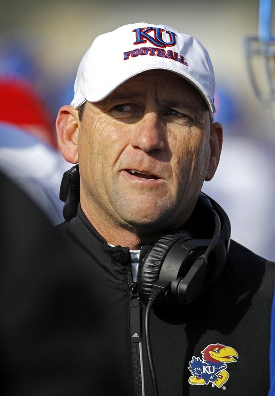 FILE - In this Nov. 10, 2018, file photo, Kansas head coach David Beaty talks to his players during the second half of an NCAA college football game against Kansas State, in Manhattan, Kan. David Beaty has already been replaced at Kansas as he gets ready to coach his final game with the Jayhawks. (AP Photo/Charlie Riedel, File)