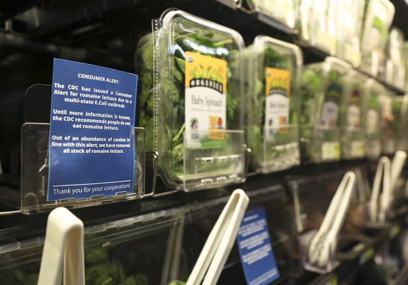 Romaine lettuce is removed from the shelves of the East End Food Co-op and other local grocery stores due to a recent consumer alert regarding a multi state E.Coli outbreak at the East End Food Co-op Tuesday, Nov. 20, 2018, in Pittsburgh. The Co-op has replaced their fresh and bagged romaine lettuce with blue signs reading,