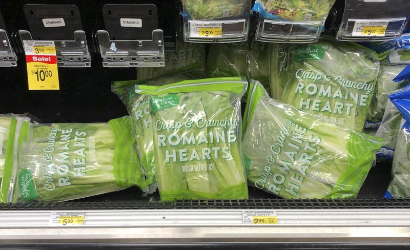 Romaine lettuce still sits on the shelves in the produce area of an Albertsons market Tuesday, Nov. 20, 2018, in Simi Valley, Calif. Health officials in the U.S. and Canada told people Tuesday to stop eating romaine lettuce because of a new E. coli outbreak. (AP Photo/Mark J. Terrill)