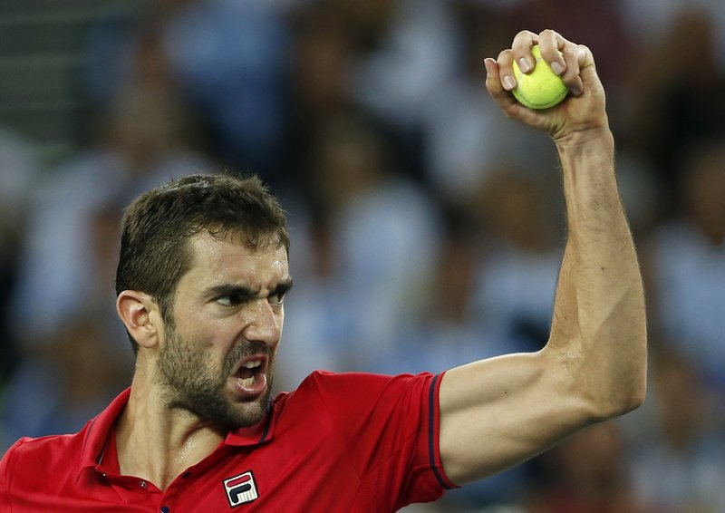FILE - In this Sunday, Nov. 27, 2016 file photo, Croatia's Marin Cilic celebrates winning a point against Argentina's Juan Martin Del Potro during their Davis Cup finals tennis singles match in Zagreb, Croatia. Yannick Noah guided France to Davis Cup titles in 1991, 1996 and 2017, but he will step down after this weekend and Amelie Mauresmo will take over. For his final match as captain of France Davis Cup team, Yannick Noah has been as meticulous as ever. (AP Photo/Darko Vojinovic, File)