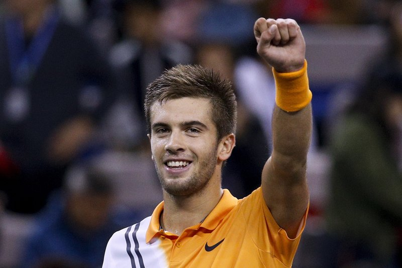 FILE - In this Saturday, Oct. 13, 2018 file picture Borna Coric of Croatia celebrates after winning his men's singles semifinals match against Roger Federer of Switzerland in the Shanghai Masters tennis tournament at Qizhong Forest Sports City Tennis Center in Shanghai, China. Yannick Noah guided France to Davis Cup titles in 1991, 1996 and 2017, but he will step down after this weekend and Amelie Mauresmo will take over. For his final match as captain of France Davis Cup team, Yannick Noah has been as meticulous as ever. (AP Photo/Andy Wong, File)