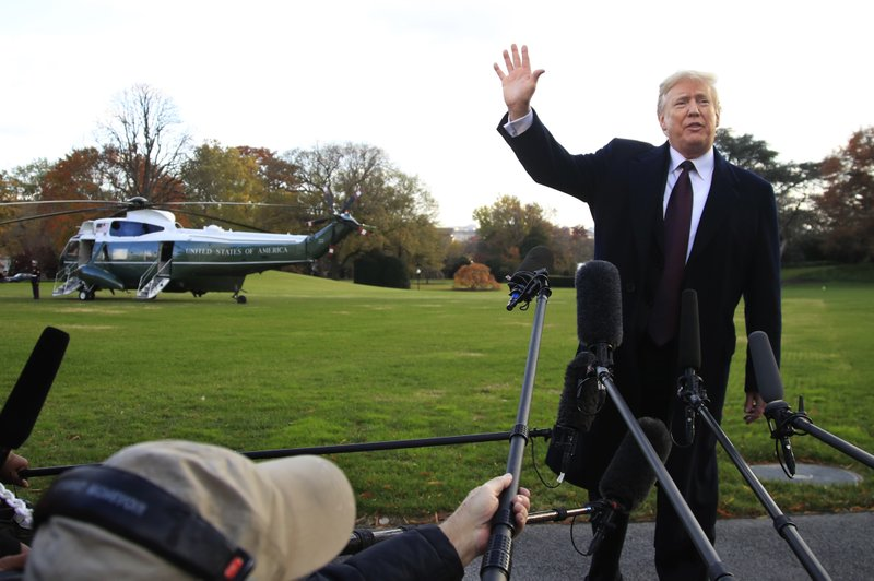 FILE- In this Tuesday, Nov. 20, 2018, file photo President Donald Trump speaks to the media before leaving the White House in Washington to travel to Florida. The Trumps are spending the Thanksgiving Day week at his Mar-a-Lago estate in Palm Beach. (AP Photo/Manuel Balce Ceneta, File)