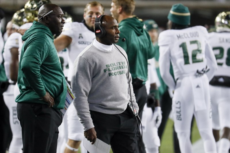 """FILE - In this Nov. 10, 2018, file photo, South Florida coach Charlie Strong, center, stands along the sideline during the first half of the team's NCAA college football game against Cincinnati in Cincinnati. South Florida plays Central Florida on Friday, Nov. 23. """"Central Florida's playing with a lot of confidence, something we don't have right now,'' Strong said. (AP Photo/John Minchillo, File)"""