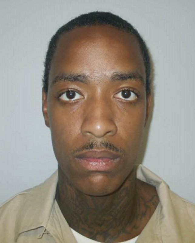 This Aug. 28, 2015 photo from the South Carolina Department of Corrections shows a booking photo of Augustus Bookert. A review of South Carolina prison homicides by The Associated Press shows that prisoners who kill often face little additional punishment. Bookert, serving five years for armed robbery, was charged with murder, which carries 30 years to life. However, he accepted a deal, pleaded guilty to voluntary manslaughter and got just 12 additional years behind bars, according to court records. (South Carolina Department of Corrections via AP)
