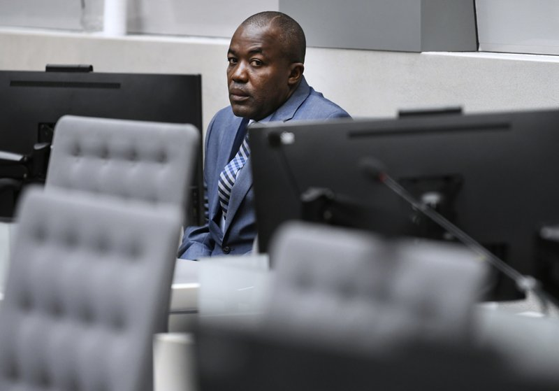 Alfred Yekatom, a Central African Republic lawmaker and militia leader who goes by the nickname Rambo, appears before the International Criminal Court, ICC, in The Hague, Netherlands, Friday Nov. 23, 2018. Prosecutors at the global court allege that 43-year-old Yekatom is responsible for crimes including murder, torture and using child soldiers during fighting in his country's bitter conflict. Yekatom has told the International Criminal Court that he was beaten and tortured after his arrest late last month in his country's parliament. (Piroschka van de Wouw, pool photo via AP)