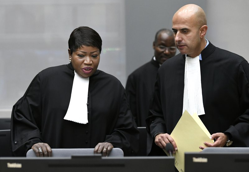 ICC's prosecutor Fatou Bensouda, left, waits for Alfred Yekatom, a Central African Republic lawmaker and militia leader who goes by the nickname Rambo, to aappear before the International Criminal Court, ICC, in The Hague, Netherlands, Friday Nov. 23, 2018. Prosecutors at the global court allege that 43-year-old Yekatom is responsible for crimes including murder, torture and using child soldiers during fighting in his country's bitter conflict. Yekatom has told the International Criminal Court that he was beaten and tortured after his arrest late last month in his country's parliament. (Piroschka van de Wouw, pool photo via AP)