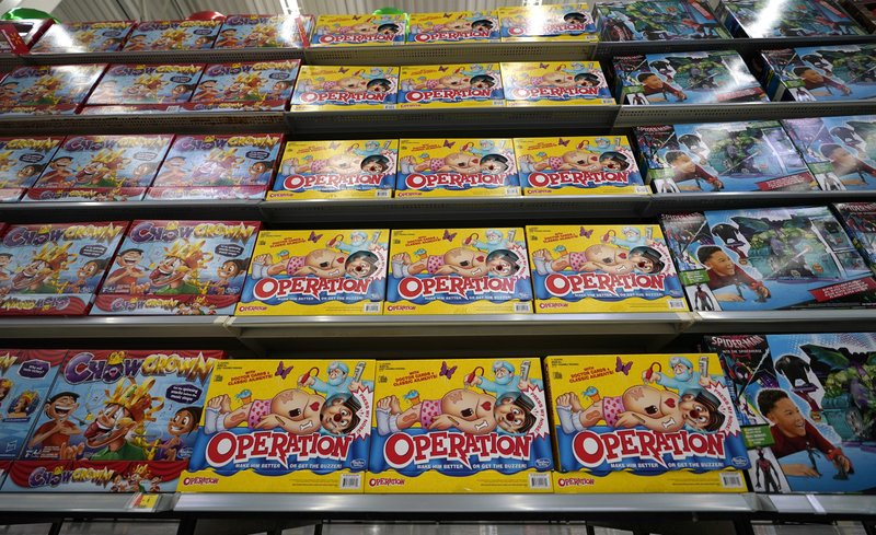 FILE- In this Nov. 9, 2018, file photo toys line the shelves in the expanded toy section at a Walmart Supercenter in Houston. Cozy sweaters and soft pajamas are in for adults. Kids, meanwhile, are asking for board games featuring fake poop and pimples. (AP Photo/David J. Phillip, File)