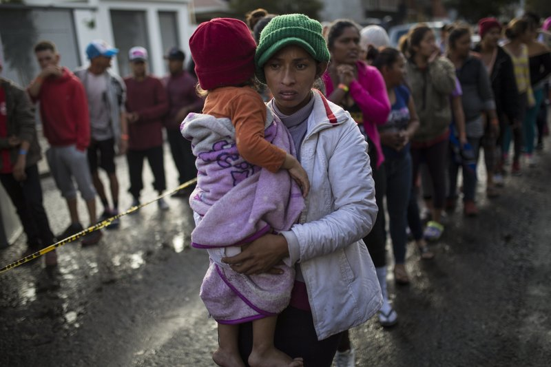 Maria del Carmen Mejia holds her daughter Britany Sofia while standing a line outside a migrant shelter in Tijuana, Mexico, Thursday, Nov. 22, 2018. U.S President Donald Trump threatened Thursday to close the U.S. border with Mexico for an undisclosed period if his administration determines that Mexico has lost