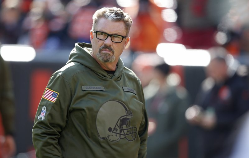 FILE - In this Nov. 11, 2018, file photo, Cleveland Browns interim coach Gregg Williams watches warm ups before an NFL football game against the Atlanta Falcons in Cleveland. The road has been cruel to the Browns, who haven't won an away game in more than three years.  Cleveland hasn't come home with a victory since Oct. 11, 2015, when then-quarterback Josh McCown led the Browns to a 33-30 overtime victory in Baltimore. They've lost their last 25 straight road games and can only avoid tying the NFL record held by the Detroit Lions (2007-10) with a win on Sunday at Cincinnati.(AP Photo/Ron Schwane, File)