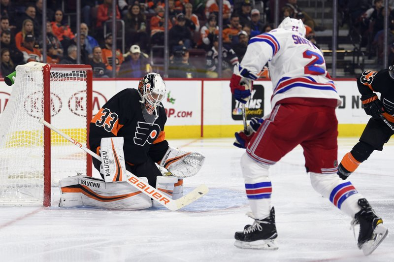 Philadelphia Flyers goaltender Calvin Pickard makes a save on a shot from New York Rangers' Kevin Shattenkirk (22) during the third period of an NHL hockey game, Friday, Nov. 23, 2018, in Philadelphia. The Flyers won 4-0. (AP Photo/Derik Hamilton)