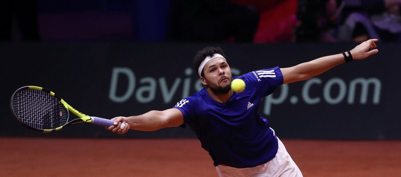 France's Jo-Wilfried Tsonga eyes the ball as he plays Croatia's Marin Cilic during the Davis Cup final between France and Croatia, Friday, Nov. 23, 2018 in Lille, northern France. (AP Photo/Thibault Camus)
