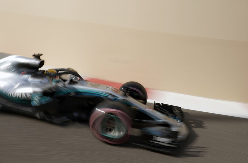 In this image taken with a slow shutter speed, Mercedes driver Lewis Hamilton of Britain steers his car during the third free practice at the Yas Marina racetrack in Abu Dhabi, United Arab Emirates, Saturday, Nov. 24, 2018. The Emirates Formula One Grand Prix will take place on Sunday. (AP Photo/Hassan Ammar)