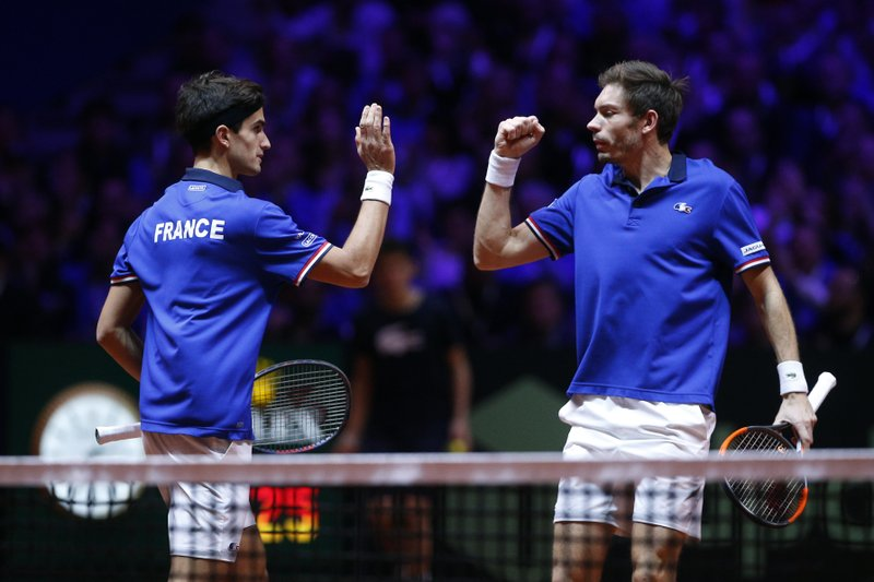 France's Nicolas Mahut, right, and Pierre Hughes Herbert celebrate after scoring a point during the Davis Cup final between France and Croatia, Saturday, Nov. 24, 2018 in Lille, northern France. Croatia is within one point of a second Davis Cup title after Borna Coric and Marin Cilic dispatched their French rivals in the opening singles matches of the final to take a 2-0 lead. (AP Photo/Thibault Camus)