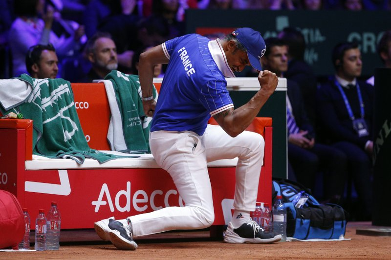 France's team captain Yannick Noah clenches his fist during the Davis Cup final between France and Croatia, Saturday, Nov. 24, 2018 in Lille, northern France. Croatia is within one point of a second Davis Cup title after Borna Coric and Marin Cilic dispatched their French rivals in the opening singles matches of the final to take a 2-0 lead. (AP Photo/Thibault Camus)