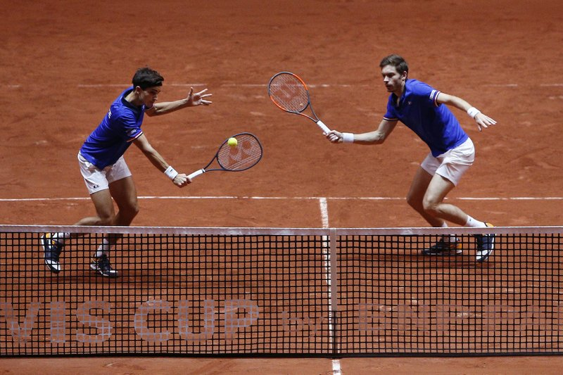 France's Nicolas Mahut, right, and Pierre Hughes Herbert return the ball to Ivan Dodig and Mate Pavic of Croatia during the Davis Cup final between France and Croatia, Saturday, Nov. 24, 2018 in Lille, northern France. Croatia is within one point of a second Davis Cup title after Borna Coric and Marin Cilic dispatched their French rivals in the opening singles matches of the final to take a 2-0 lead. (AP Photo/Thibault Camus)