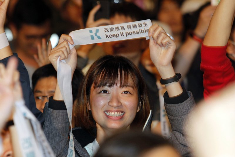 A supporter of Taipei city mayor and city mayoral candidate Ko Wen-je cheer for Ko''s victory with slogan
