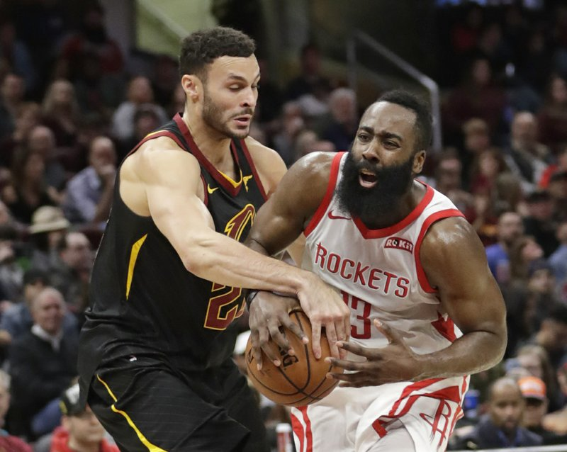 Cleveland Cavaliers' Larry Nance Jr. (22) knocks the ball loose from Houston Rockets' James Harden (13) in the second half of an NBA basketball game, Saturday, Nov. 24, 2018, in Cleveland. (AP Photo/Tony Dejak)