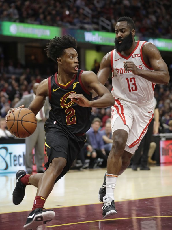 Cleveland Cavaliers' Collin Sexton (2) drives past Houston Rockets' James Harden (13) in the first half of an NBA basketball game, Saturday, Nov. 24, 2018, in Cleveland. (AP Photo/Tony Dejak)