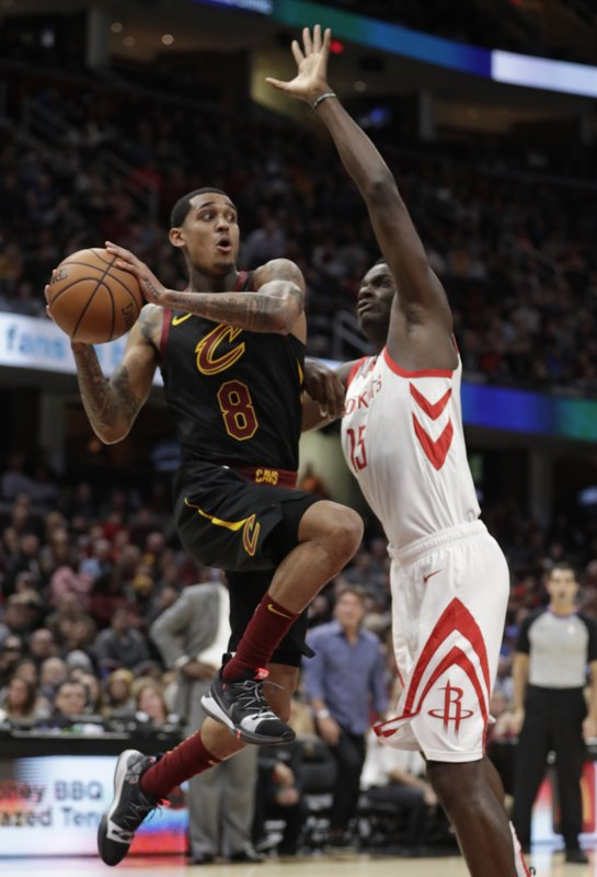 Cleveland Cavaliers' Jordan Clarkson (8) looks to pass against Houston Rockets' Clint Capela (15), from Switzerland, in the first half of an NBA basketball game, Saturday, Nov. 24, 2018, in Cleveland. (AP Photo/Tony Dejak)