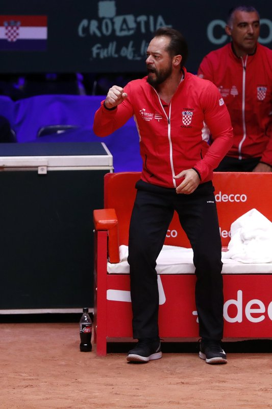 Croatia's team captain Zeljko Krajan reacts as Croatia's Marin Cilic plays France's Lucas Pouille during the Davis Cup final between France and Croatia Sunday, Nov. 25, 2018 in Lille, northern France. (AP Photo/Thibault Camus)
