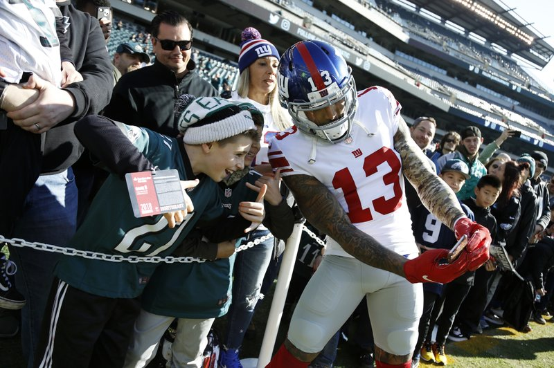 New York Giants wide receiver Odell Beckham poses for a photograph with fans before an NFL football game against the Philadelphia Eagles, Sunday, Nov. 25, 2018, in Philadelphia. (AP Photo/Chris Szagola)