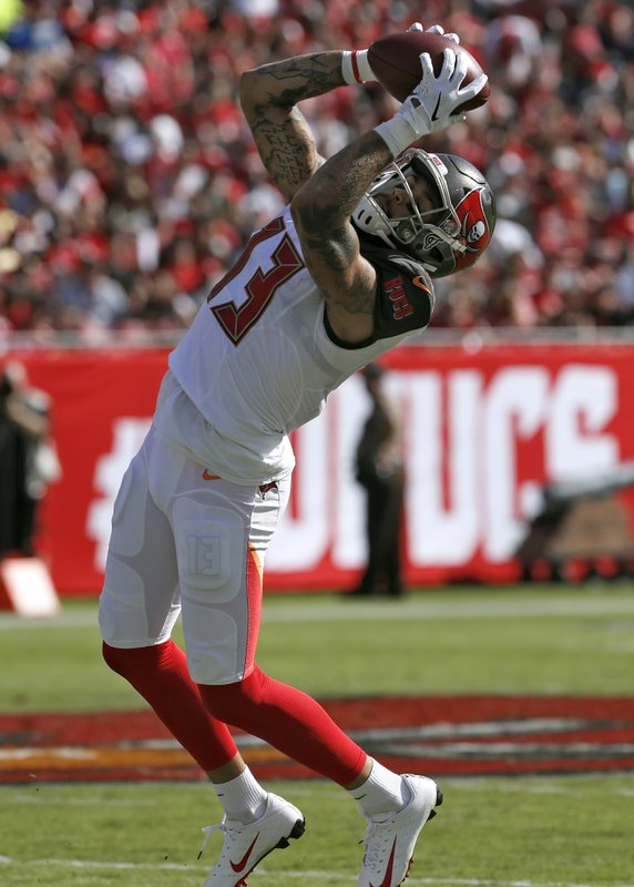 Tampa Bay Buccaneers wide receiver Mike Evans (13) makes a reception during the first half of an NFL football game against the San Francisco 49ers Sunday, Nov. 25, 2018, in Tampa, Fla. (AP Photo/Mark LoMoglio)