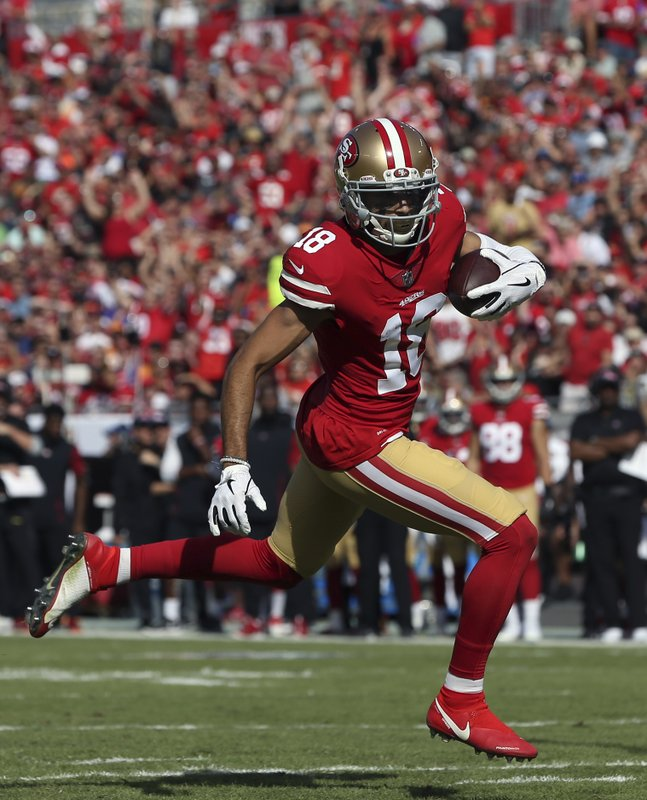San Francisco 49ers wide receiver Dante Pettis (18) heads for the endzone after a 13-yard touchdown reception from Nick Mullens during the first half of an NFL football game against the Tampa Bay Buccaneers Sunday, Nov. 25, 2018, in Tampa, Fla. (AP Photo/Mark LoMoglio)