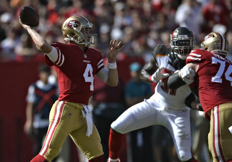 San Francisco 49ers quarterback Nick Mullens (4) throws a pass against the Tampa Bay Buccaneers during the first half of an NFL football game Sunday, Nov. 25, 2018, in Tampa, Fla. (AP Photo/Jason Behnken)