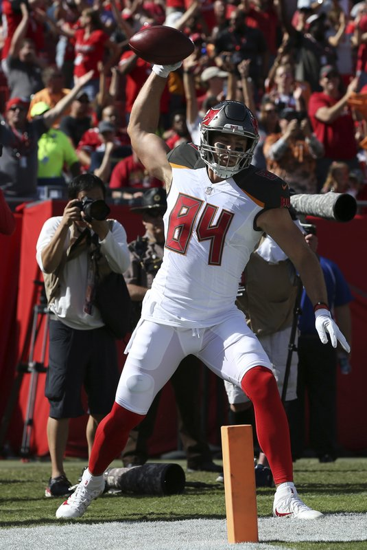 Tampa Bay Buccaneers tight end Cameron Brate (84) spikes the football after his touchdown reception during the first half of an NFL football game against the San Francisco 49ers Sunday, Nov. 25, 2018, in Tampa, Fla. (AP Photo/Mark LoMoglio)