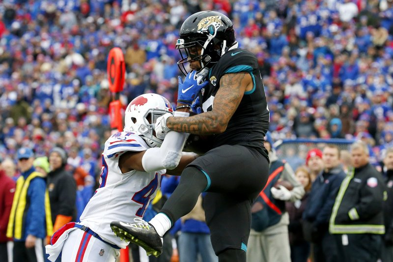 Jacksonville Jaguars wide receiver Donte Moncrief, right, makes a catch against Buffalo Bills defensive back Levi Wallace during the second half of an NFL football game, Sunday, Nov. 25, 2018, in Orchard Park, N.Y. (AP Photo/Jeffrey T. Barnes)