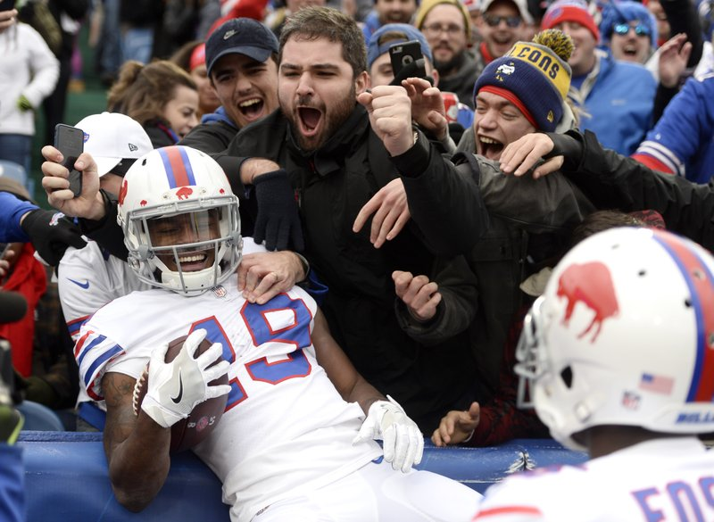 Buffalo Bills wide receiver Isaiah McKenzie (19) celebrates his touchdown run with fans during the first half of an NFL football game against the Jacksonville Jaguars, Sunday, Nov. 25, 2018, in Orchard Park, N.Y. (AP Photo/Adrian Kraus)