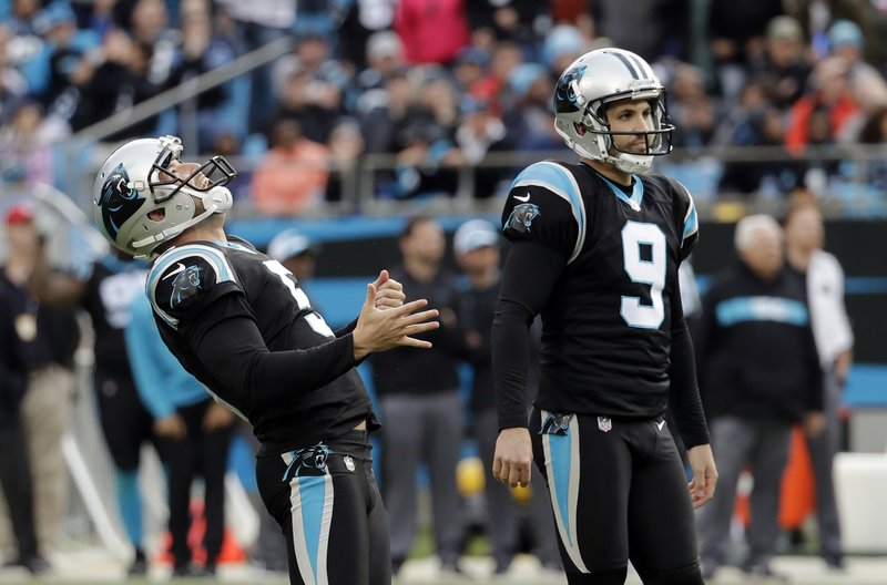 Carolina Panthers' Graham Gano (9) and Michael Palardy (5) watch as Gano's field attempt against the Seattle Seahawks goes wide during the second half of an NFL football game in Charlotte, N.C., Sunday, Nov. 25, 2018. Seattle won 30-27 on a last second field goal by Sebastian Janikowski. (AP Photo/Chuck Burton)