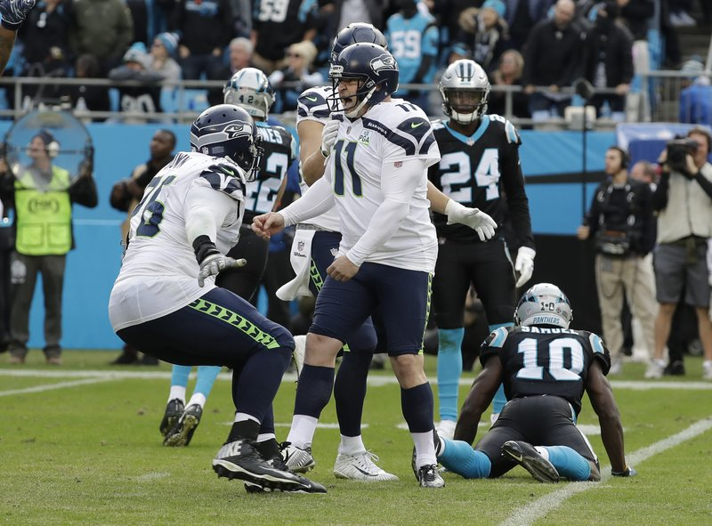 Seattle Seahawks' Sebastian Janikowski (11) celebrates after his game-winning field goal against the Carolina Panthers during the second half of an NFL football game in Charlotte, N.C., Sunday, Nov. 25, 2018. (AP Photo/Chuck Burton)
